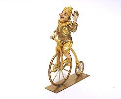 clown bike, gold